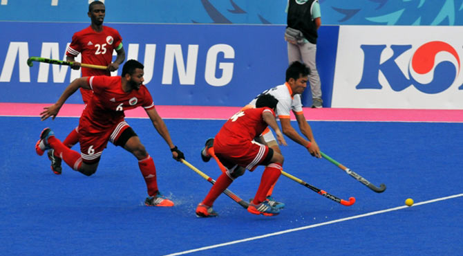 Action in the Asian Games match between India and Oman.