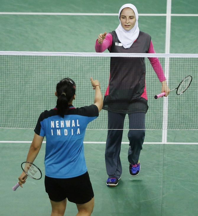 Iran's Aghaei Hajiagha Soraya, right, shakes hands after losing to India's Saina Nehwal