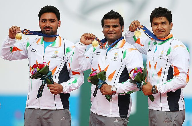 Gold medalists, Rajat Chauhan, Sandeep Kumar and Abhishek Verma of India on the podium following their Men's Compound Men's Team Gold Medal Match during the 2014 Asian Games at Gyeyang Asiad Archery Field on Saturday