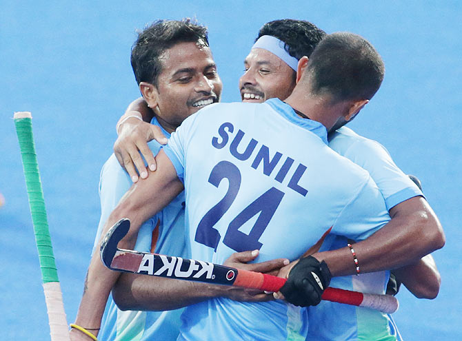 Birendra Lakra of India celebrates after scores a goal during the Hockey Men's Pool B match between India and China on Saturday