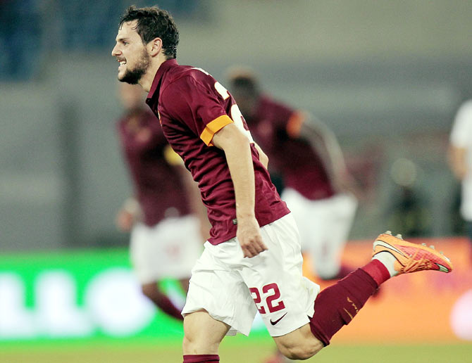 Mattia Destro of AS Roma celebrates after scoring against Hellas Verona FC during their Serie A match at Stadio Olimpico on Friday