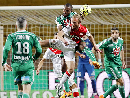Monaco's Valere Germain (centre) challenges Saint Etienne's Kevin Theophile (top centre) during their Ligue 1 soccer match at Louis II stadium in Monaco on Friday