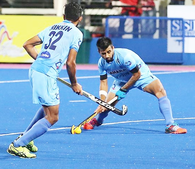 India's Manpreet Singh (right) in action