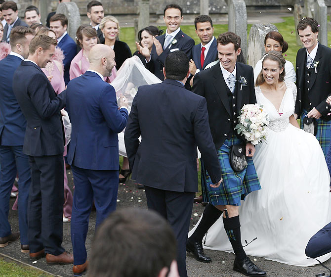 Tennis player Andy Murray and wife Kim Sears are greeted by guests as they leave the cathedral after their wedding at a cathedral in Dunblane, Scotland, on Saturday