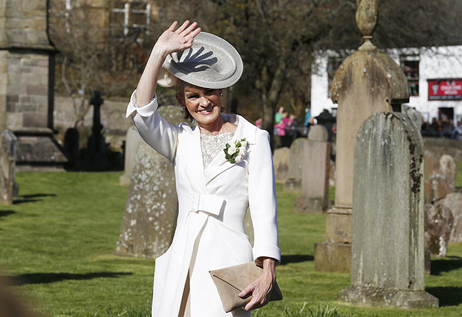 Judy Murray waves as she arrives at the cathderal for the wedding of her son tennis player Andy Murray to Kim Sears