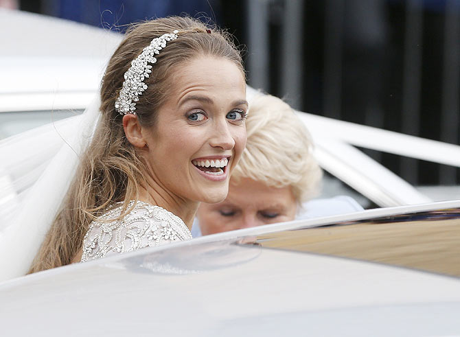 Kim Sears smiles as she leaves the cathedral