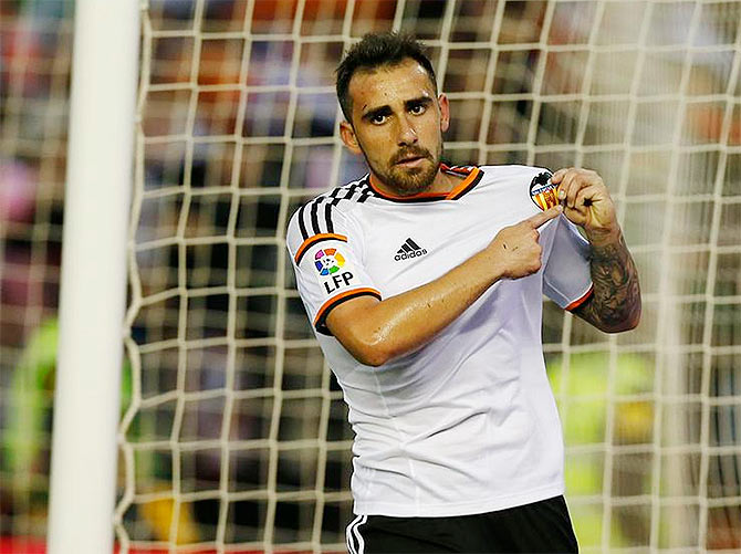 Valencia's Paco Alcacer celebrates on scoring the opening goal against Levante on Monday