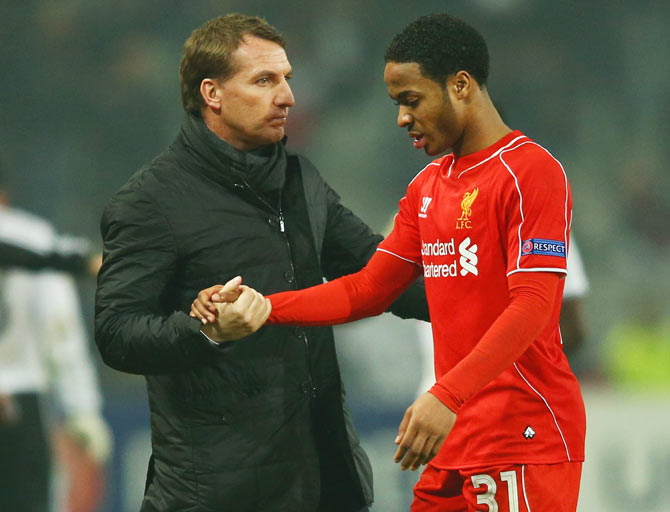 Liverpool manager Brendan Rodgers with Raheem Sterling