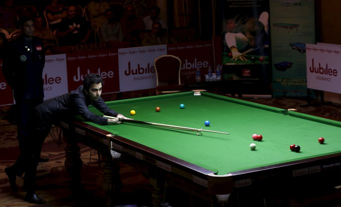 India's Pankaj Advani plays a shot during his snooker match