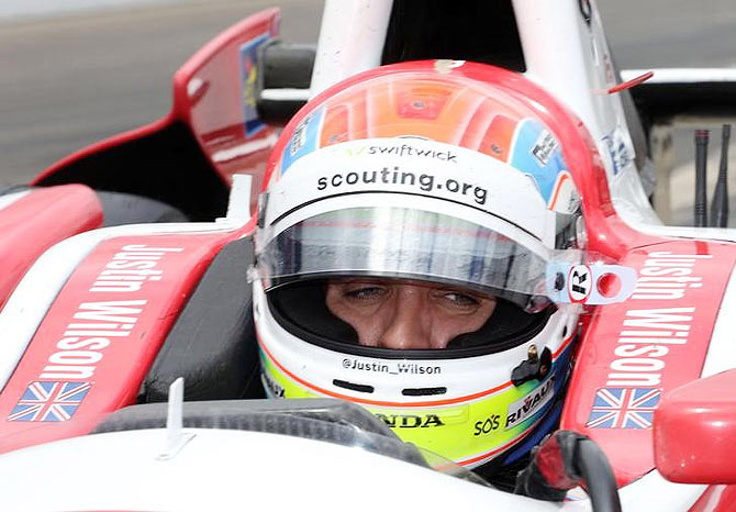 IndyCar Series driver Justin Wilson sits in his car during practice for the 2014 Indianapolis 500 at Indianapolis Motor Speedway