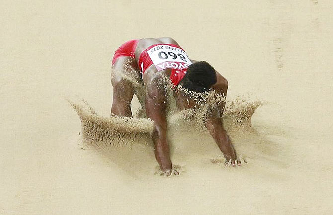 The USA's Tianna Bartoletta competes in the women's long jump final on Friday