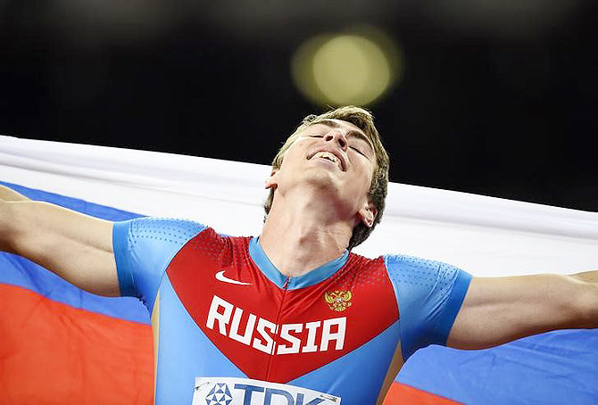 Russia's Sergey Shubenkov celebrates after winning the men's 110 metres hurdles final during the 15th IAAF World Championships at the National Stadium in Beijing, on Friday