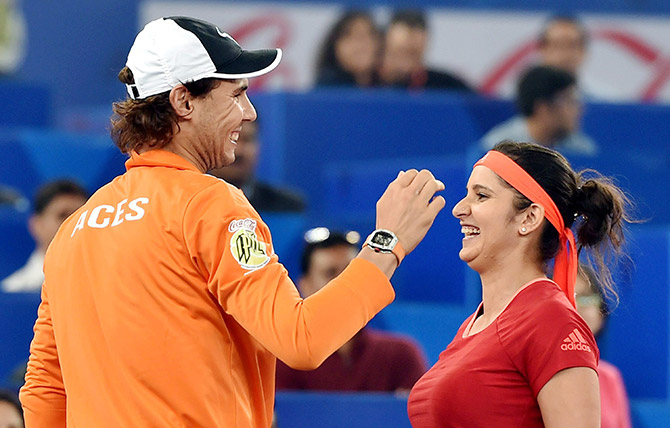 India's Sania Mirza being greeted by Rafel Nadal