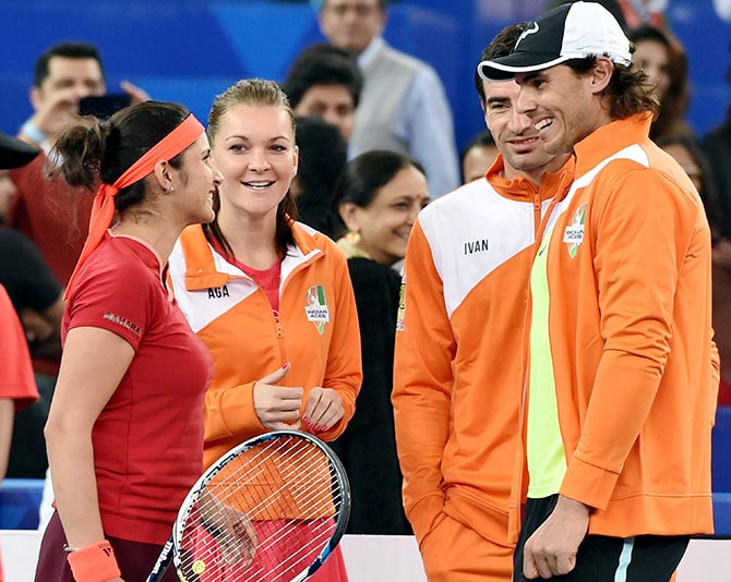 India's Sania Mirza being greeted by Rafael Nadal