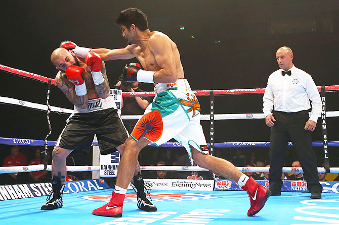 Vijender Singh lands a punch on Samet Hyuseinov during their Middleweight bout at the Manchester Arena on Saturday