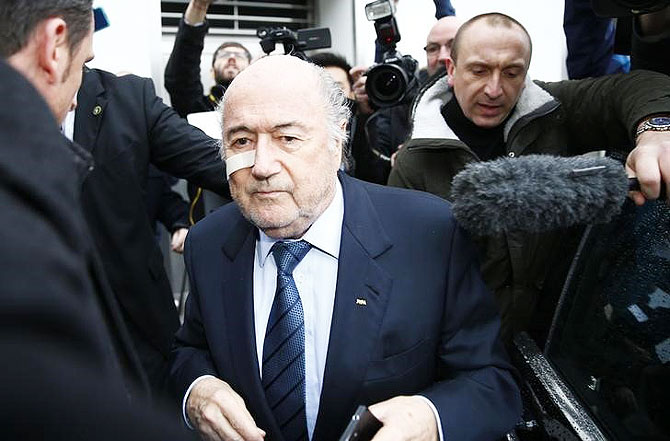 FIFA President Sepp Blatter is surrounded by media as he arrives for a news conference in Zurich on Monday