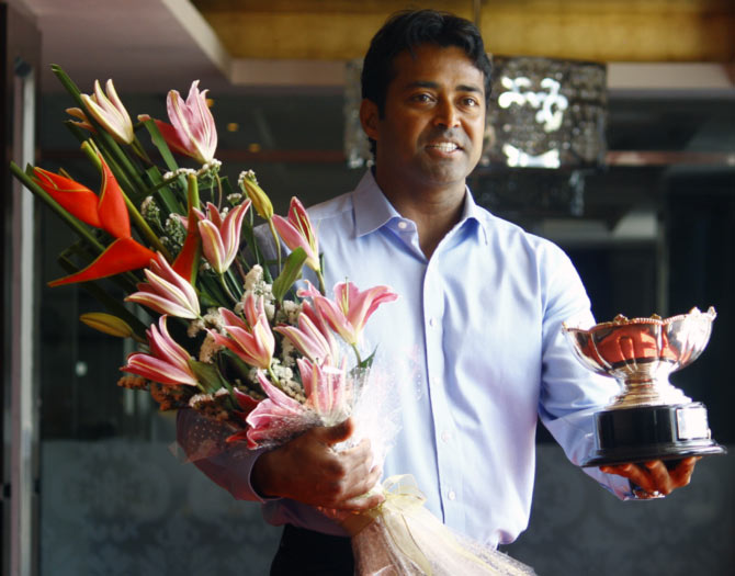 Leander Paes poses with the 2015 Australian Open mixed doubles trophy