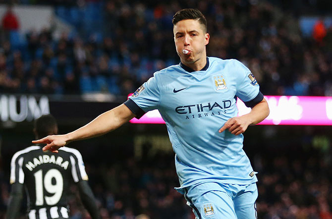 Samir Nasri of Manchester City celebrates scoring the second goal against Newcastle United during their English Premier League match at Etihad Stadium in Manchester on Saturday