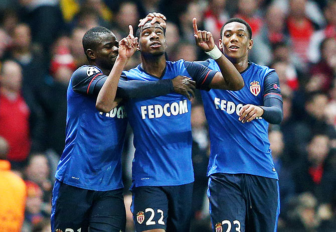 Geoffrey Kondogbia #22 (centre) of Monaco celebates with teammates after scoring the opening goal against Arsenal during the UEFA Champions League round of 16, first leg match at The Emirates Stadium in London on Wednesday