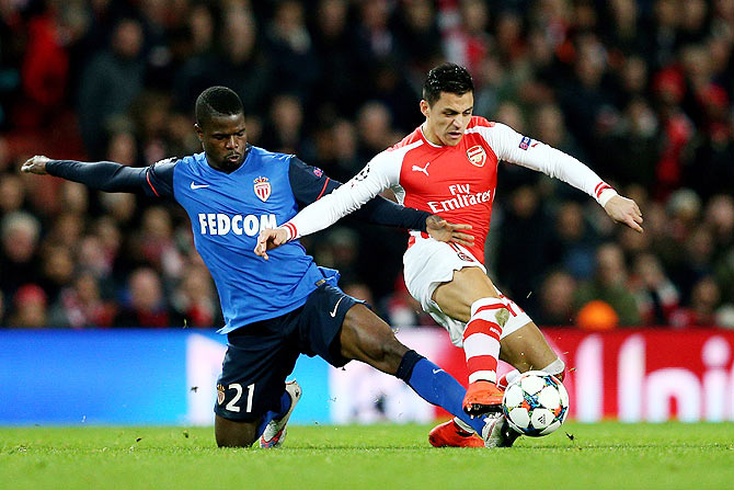 Alexis Sanchez of Arsenal is tackled by Elderson Uwa Echiejile of Monaco during the UEFA Champions League round of 16, first leg match