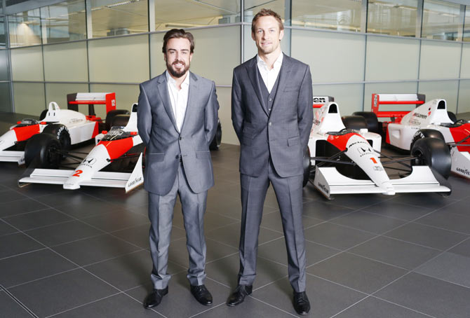 Formula One drivers Fernando Alonso, left, and Jenson Button pose
