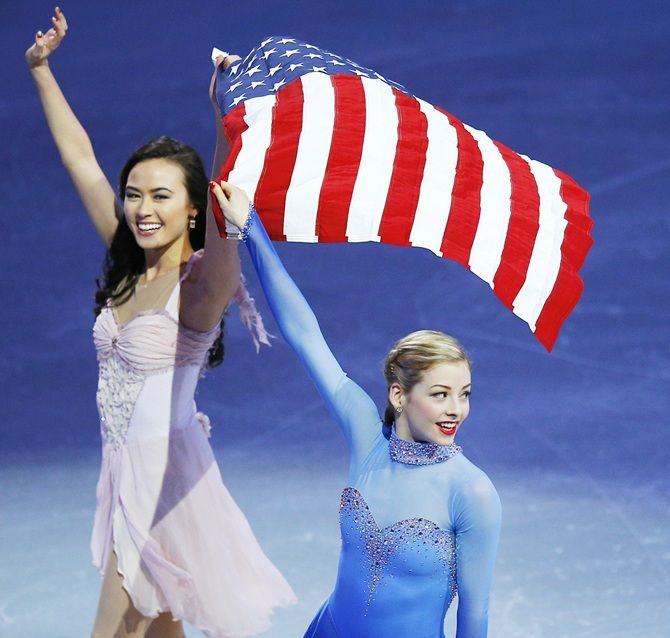 Team USA's Olympic figure skating team members Madison Chock and Gracie   Gold wave to the crowd in Boston