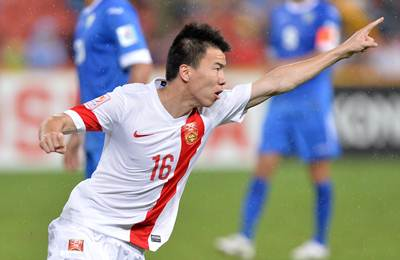 Sun Ke of China celebrates after scoring during the 2015 Asian Cup match against Uzbekistan at Suncorp Stadium in Brisbane, Australia.