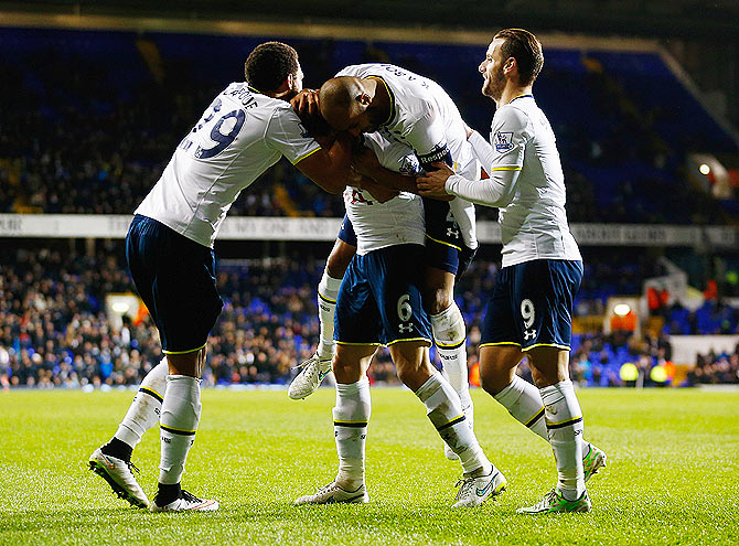 Vlad Chiriches of Spurs (6) celebrates with teammates after scoring their third goal during the FA Cup third round Replay match against Burnley at White Hart Lane in London on Wednesday