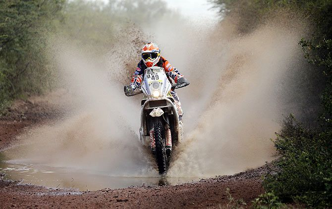 KTM rider Emanuel Gyenes of Romania rides during the 12th stage of the Dakar Rally 2015 from Termas de Rio Hondo to Rosario on January 16