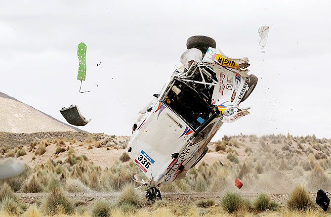 Juan Manuel Silva and Pablo Sisterna of Argentina crash in their Mercedes car during the 7th stage of the Dakar Rally from Iquique to Uyuni, Bolivia on January 10
