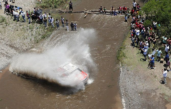 Toyota driver Bernhard Ten Brinke of the Netherlands crosses a river during the 11th stage of the Dakar Rally 2015 from Cachi to Termas de Rio Hondo, Argentina on January 15