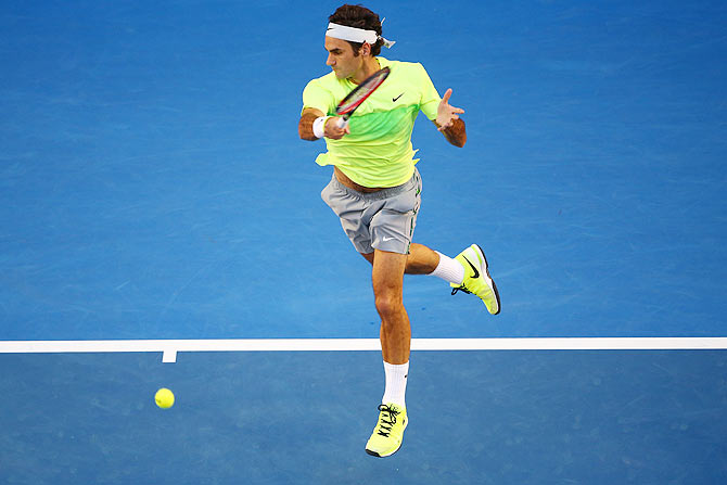 Roger Federer of Switzerland plays a forehand in his first round match against Yen-Hsun Lu of Chinese Taipei at the 2015 Australian Open at Melbourne Park on Monday