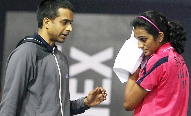Why coach Gopichand is not travelling with Sindhu