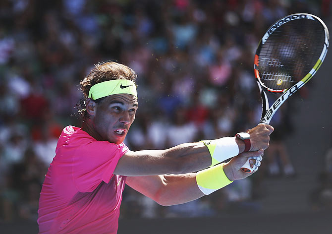 Rafael Nadal of Spain plays a forehand in his first round match against Mikhail Youzhny of Russia on Tuesday