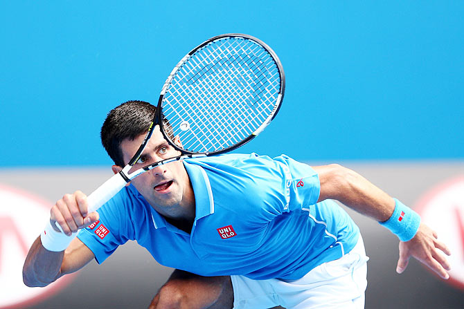 Novak Djokovic of Serbia plays a forehand in his first round match against Aljaz Bedene of Slovenia on Tuesday