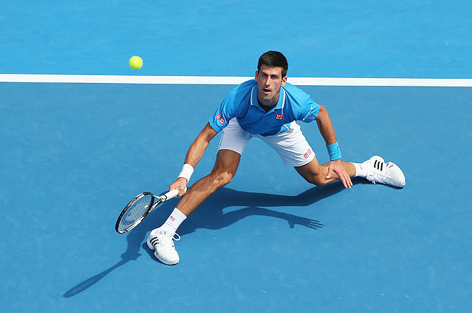 Novak Djokovic of Serbia plays a backhand against Aljaz Bedene of Slovenia in his first round match of the 2015 Australian Open at Melbourne Park on Tuesday