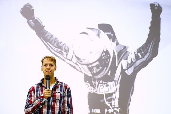 Sebastian Vettel of Germany speaks on stage during a visit to the Red Bull Racing Factory