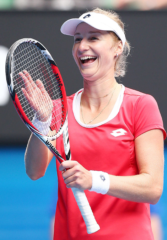 Ekaterina Makarova of Russia celebrates after beating Simona Halep of Romania to win the quarter-final