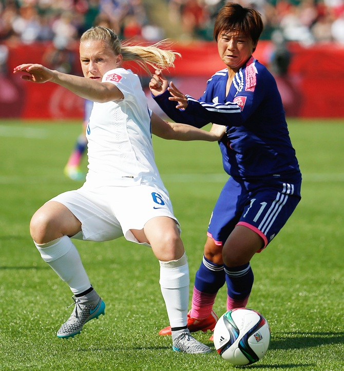 Laura Bassett of England in action with Shinobu Ohno of Japan