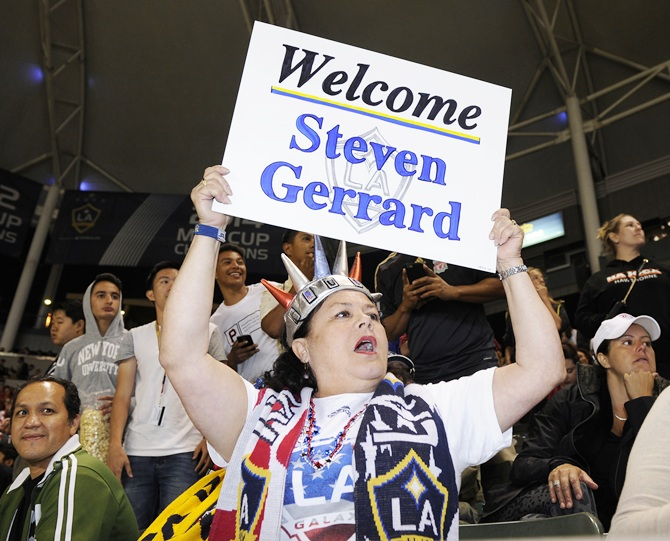 A fan holds a welcome sign as the new Los Angeles Galaxy midfielder Steven Gerrard