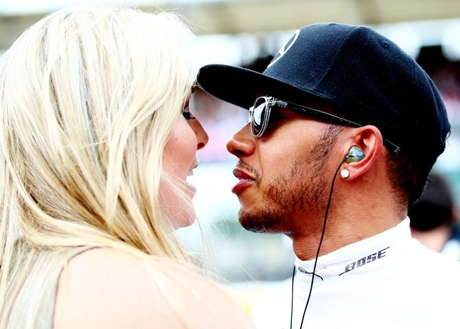 Lewis Hamilton of Great Britain and Mercedes GP speaks with Lindsey Vonn