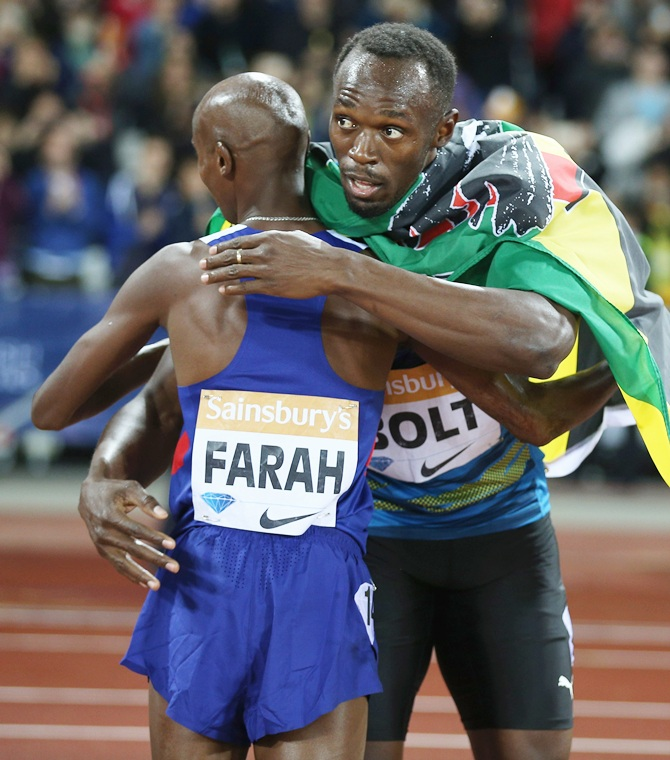 Usain Bolt of Jamaica, right, congratulates Mo Farah
