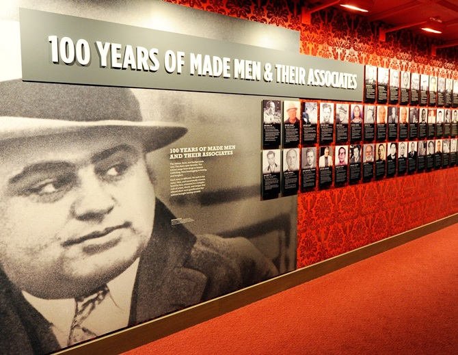 A wall of images of mobsters is displayed at The Mob Museum