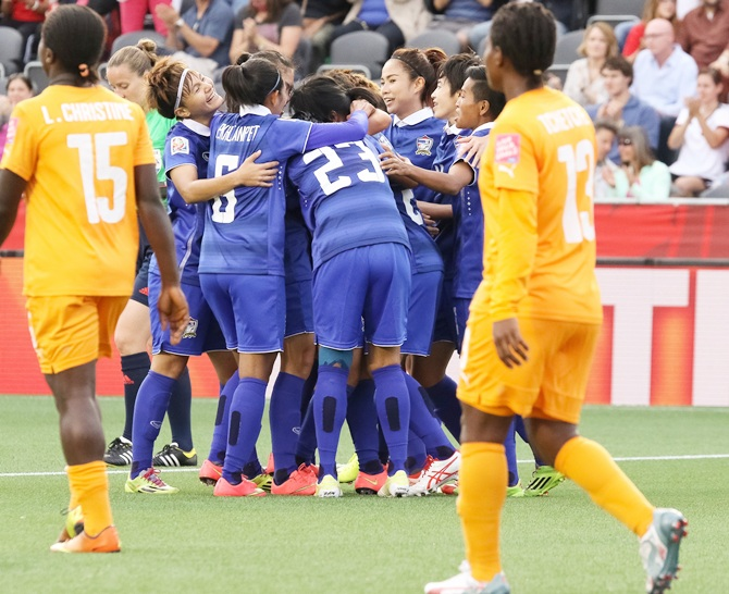 Thailand's players celebrate the first goal by Orathai Srimanee
