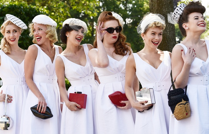 Race goers pose on Ladies Day