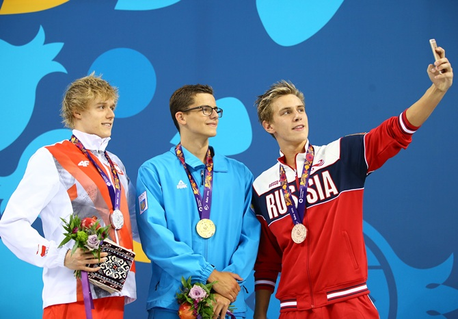 From left, silver medalist Pawel Sendyk of Poland, gold medalist Andril Khloptsov of Ukraine and bronze medalist Daniil Pakhomov of Russia pose with the medals won during the Men's 50m Butterfly final