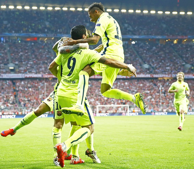 Neymar celebrates with Luis Suarez