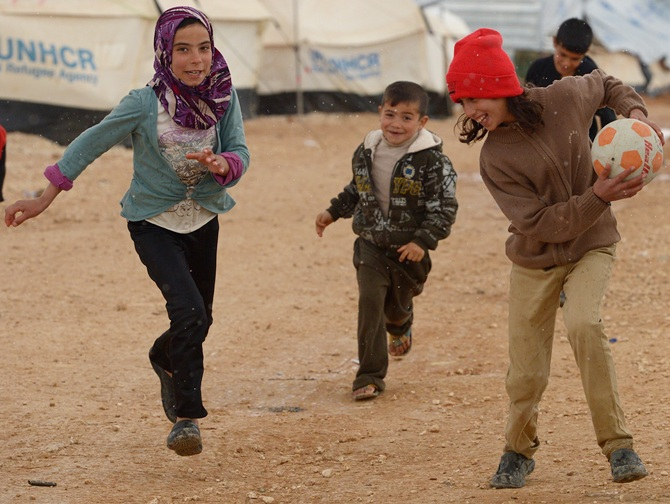 Syrian refugee children play