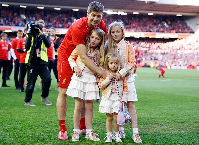 Steven Gerrard poses on the pitch with his family