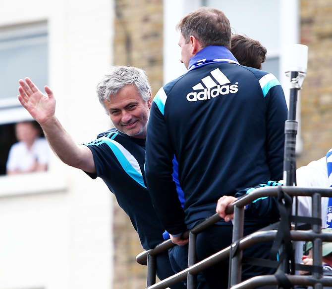 Chelsea manager Jose Mourinho waves to the Chelsea fans
